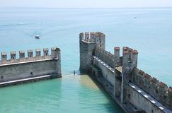 Mediaeval-port. Castle-walls of the castle of scaligers, Sirmione, Lake Garda, Italy - the wall is open to the seaside - ships can go into the protectiv walls Royalty Free Stock Images
