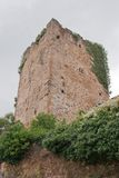 Mediaeval Tower of Mogrovejo. Mogrovejo is a village into the mountain scenary of Picos de Europa in Spain. Its houses of stone and brick were built in the 16 Stock Photography