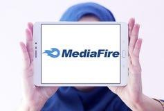 MediaFire file hosting website logo. Logo of MediaFire on samsung tablet holded by arab muslim woman. MediaFire is a file hosting, file synchronization, and stock images