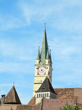 Medias downtown with defense towers and famous Saxon Tower. Medias, Transylvania. Cityscape of downtown in medieval city with fortified church tower, landmark Royalty Free Stock Photography