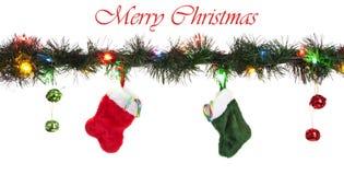 Medias rojas y verdes con el bastón de caramelo Imagen de archivo libre de regalías