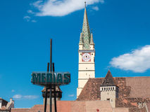 Medias Romania city symbol. Old saxon Cathedral clock tower in t Royalty Free Stock Photography