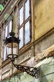 Medias urban architecture, Transylvania, Romania. Old street lantern on the wall of a beautiful old building at Piata Regele Ferdinand I or King Ferdinand I royalty free stock image