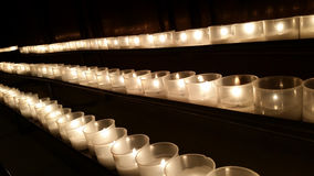 Mediate with Other Dimensions. Candles in a row to remember the dead and saints Royalty Free Stock Photo