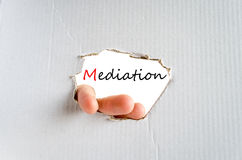 Mediation Concept. Hand on the cardboard background mediation concept Royalty Free Stock Photography