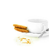 Mediation Concept Image. Concept image for mediation or business meeting, interview etc. Crumbly biscuits and a stylish, modern cup, saucer and spoon against a Stock Photography