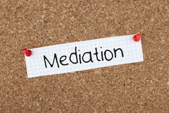 Mediation. Concept word on cork bulletin board Stock Images