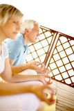 Mediation. Two seniors mediating on veranda, the focus is on man Stock Images