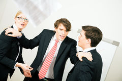 The mediator. Business: Team having a serious argument, one colleague being the mediator Royalty Free Stock Images