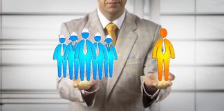 Mediator Balancing Five Workers And One Manager. Unrecognizable mediator balancing blue collar workers and one white collar. Concept for human resources Royalty Free Stock Photos
