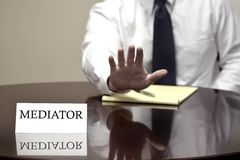 MediatorAt Desk Holding Hand Up Royalty Free Stock Photography