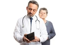 Medic checking wallet with patient looking stock images