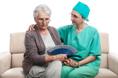 Medic comforting old woman Royalty Free Stock Images