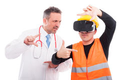 Medic copying constructor gesturing on reality glasses Royalty Free Stock Photos