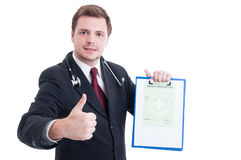 Medic or doctor holding medical prescription and showing like Stock Photos