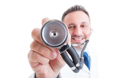Medic or doctor holding stethoscope with focus on it Royalty Free Stock Image
