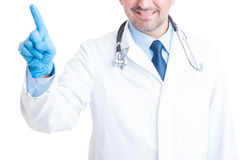 Medic or doctor pressing invisible button on transparent screen Royalty Free Stock Image