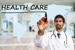 Medic drawing line under health care text stock photo