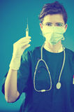 Medic with injection Royalty Free Stock Photo