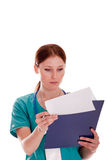Medic looking at her report Royalty Free Stock Photography