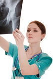 Medic looking at the x-ray image Stock Photography