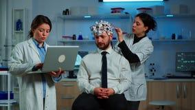 Medic in neuroscience working in neurological research laboratory