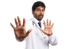 Medic palms to camera as stay there sign royalty free stock image