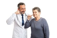 Medic and patient holding fingers as phone concept stock photography