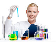 Medic researcher holds vial full of blue liquid Royalty Free Stock Image