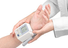 Medic's hands, measuring blood pressure Royalty Free Stock Images