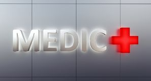 Medic sign front view on steel facade with back light and red cross sign Stock Photography