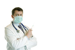 Medic with stethoscope, mask and injection. Medic with stethoscope, mask and and injection looks into camera Royalty Free Stock Images