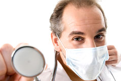 Medic with stethoscope and medical mask. Medic with stethoscope and medical mask on white background Royalty Free Stock Photography