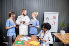 Medic talking indoors stock photo