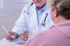 Medic talking with patient Royalty Free Stock Photos