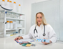 Medic with a tray full of pills Stock Images