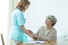 Medic visiting her old patient. Picture of medic visiting her female old patient at home stock images