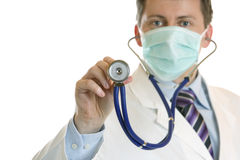 Medic wants to hear the heartbeat with stethoscope. Medic with mask and stethoscope is ready for listening to heartbeat Royalty Free Stock Images