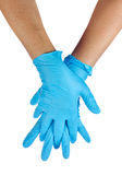 Medic wearing a blue latex gloves Stock Photography