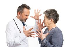 Medic and woman arguing royalty free stock photos
