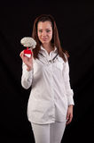 Medic woman holding a human brain model against black background Royalty Free Stock Photo