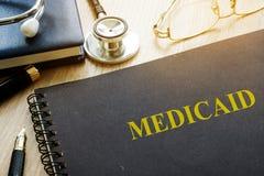 medicaid Documentos, pluma y estetoscopio fotos de archivo libres de regalías