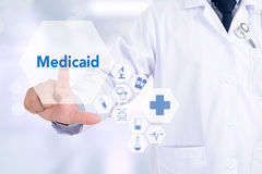 Medicaid. Medicine doctor working with computer interface as medical Stock Photos
