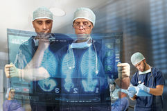 Medical. Doctors in a medical facility looking at digital screen Stock Image