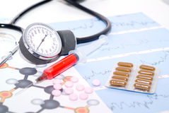 Medical. Tablets on a background of medical diagrams Stock Photo