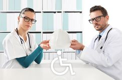 medical accident insurance concept, doctors hands with protection helmet and wheelchair icon stock illustration