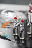 Medical ampoule and syringe. Stock Photos