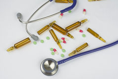 Medical ampoules, pills and stethoscope Royalty Free Stock Photos