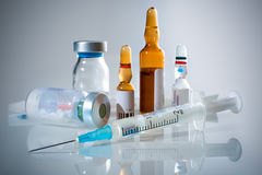 Medical ampoules and syringe. Medical ampoules and a syringe stock images