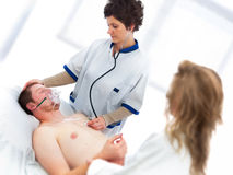 Medical assistance on young man royalty free stock photos